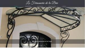 Ferronnerie d'Art de la Brie : portail, rambarde et rampe en fer forgé.